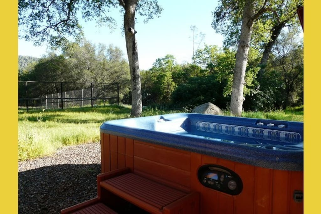 The 4-person hot tub is in a quiet and relaxing location.