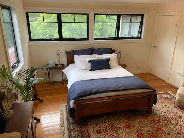 Large double bedroom with private access.