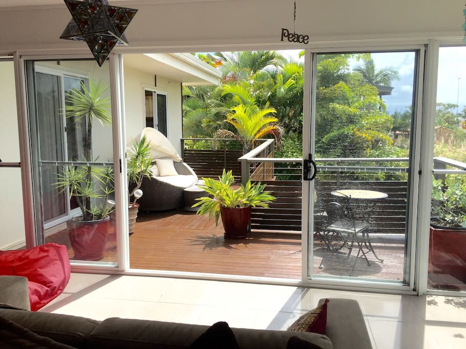 Upstairs - Beautiful front balcony - watch the sunrise on the daybed or enjoy the warmth of the east facing sun during the day!