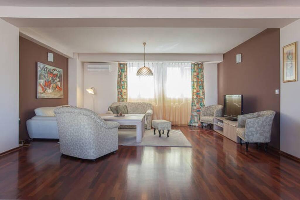 A big, warm and cozy living room.