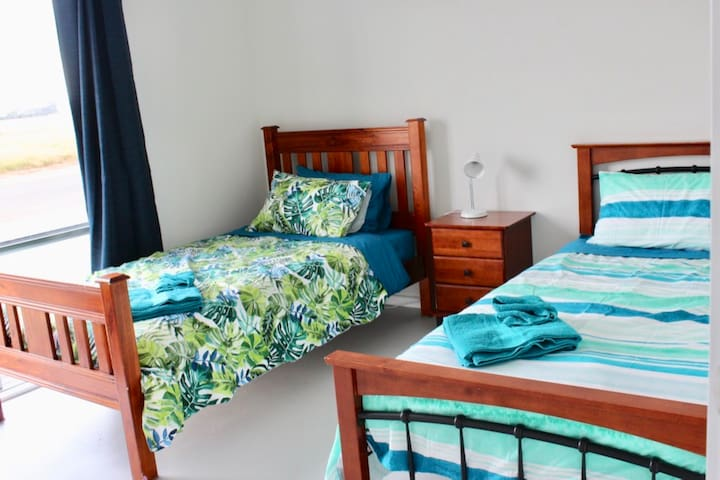 2 King Single beds downstairs