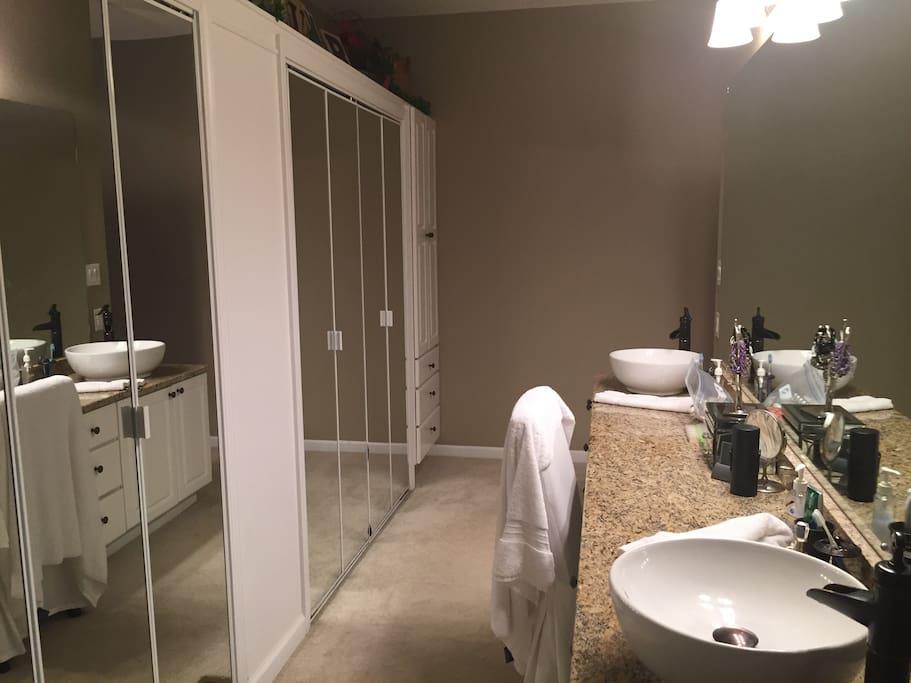 Master bathroom with dual vanity and jacuzzi bath
