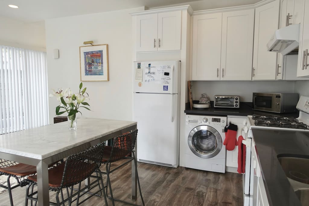Dining table for 4. Washer-dryer combo.