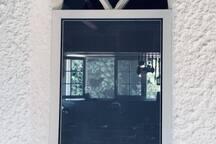 Peeping through one of the two kitchen windows