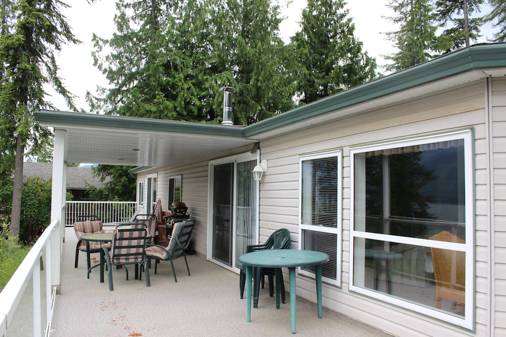 Large deck with tables/chairs/BBQ