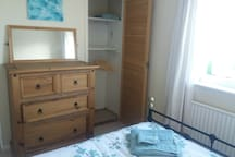 Double bed, front view, cupboard and wardrobe space
