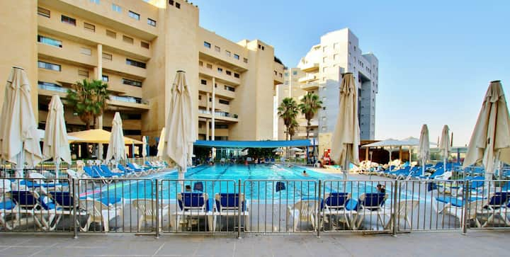 Huge apartment by the beach with gym , spa & pool