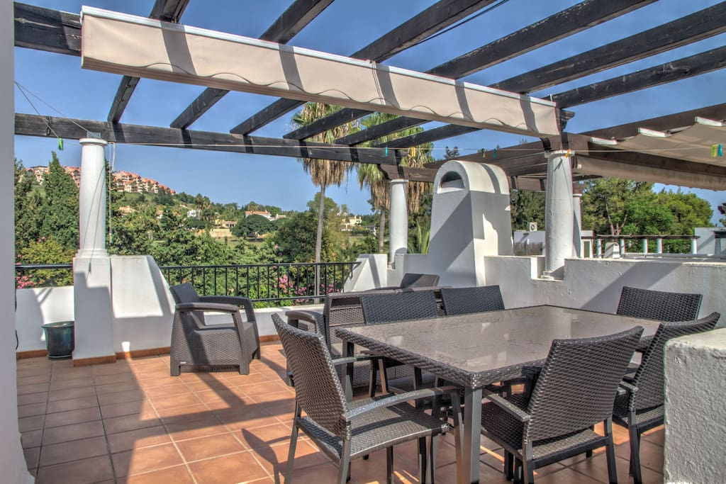 Roof top terrace with bbq, table, lounge and sun loungers