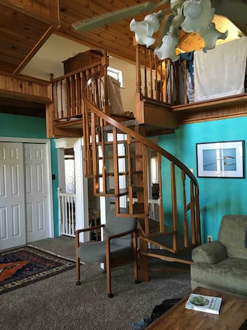 The livingroom, with spiral staircase to the second floor.
