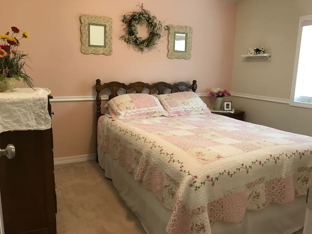 Another bedroom—nice queen bed, dresser and closet