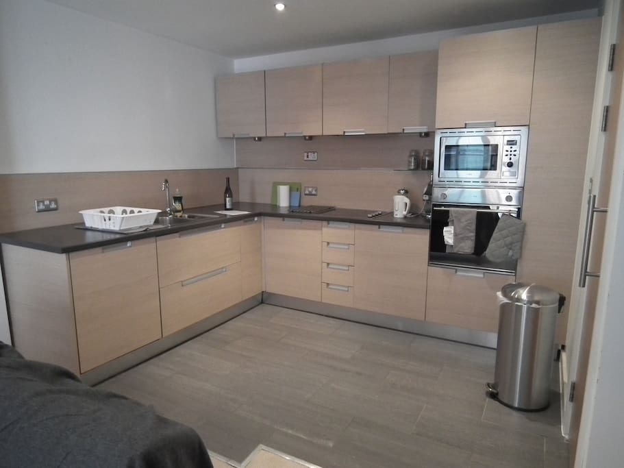 Large kitchen with microwave, oven and fridge/freezer