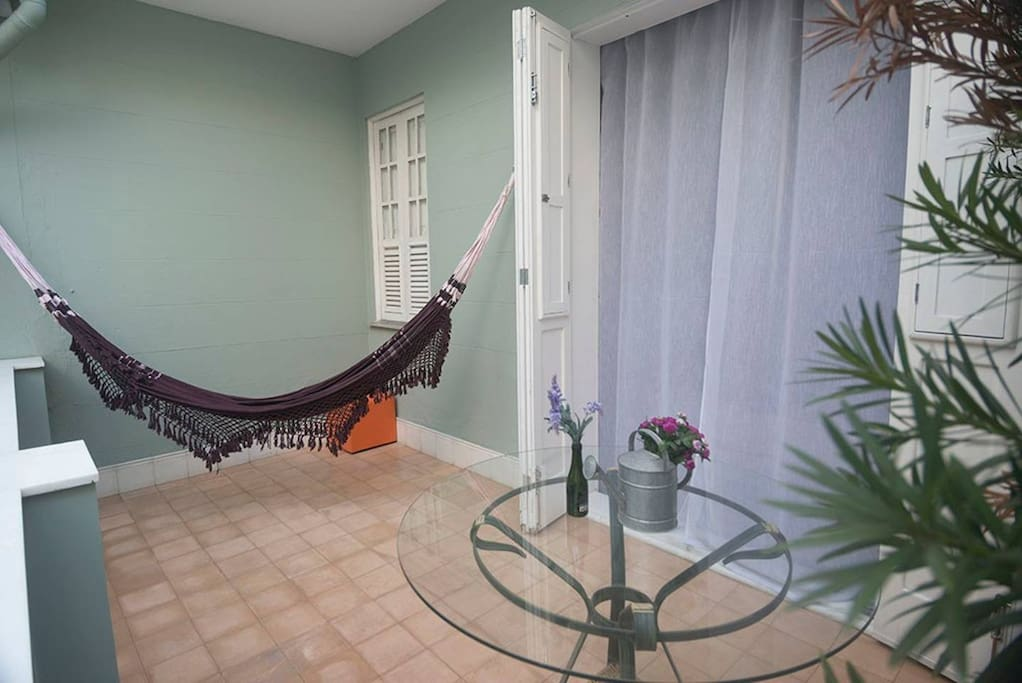 The private veranda with hammock and table