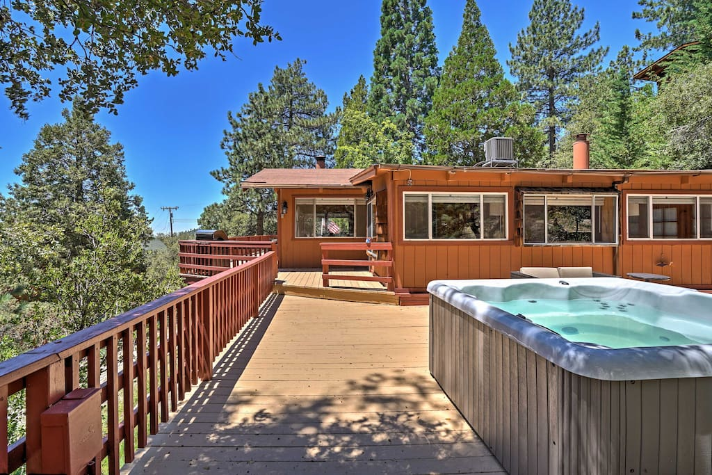 The incredible home features a private hot tub on the back deck.