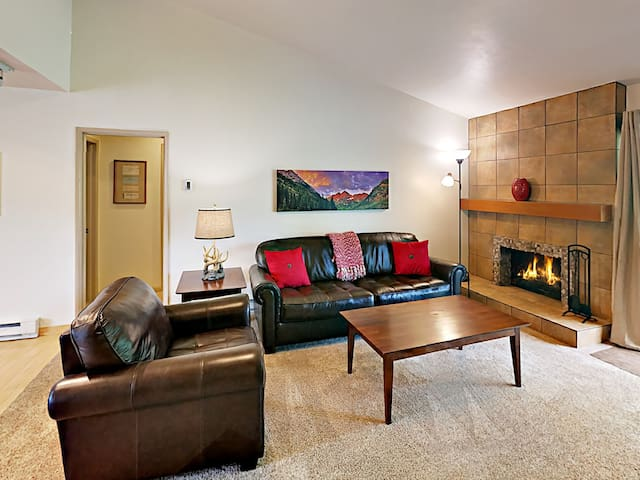 The living room has comfortable seating on leather sofas.