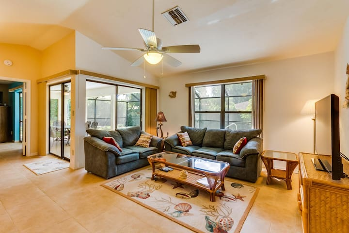 Spacious ranch home w/ a screened-in pool, hot tub, beaches one mile west!