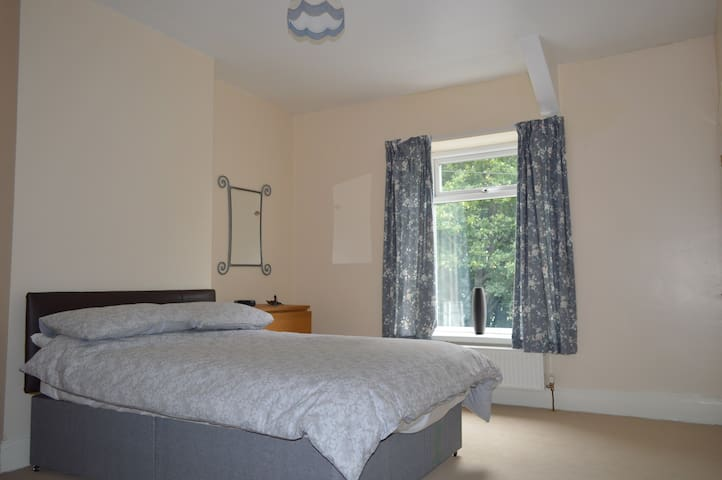 Bedroom. Double bed, built-in wardrobe, draws, towels and hairdryer.
