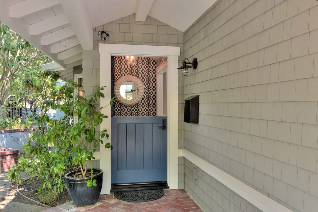 Dutch door opens to the entrance of the home.