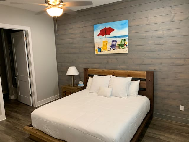 """Mater bedroom has a king sized bed, the room is spacious and it has a 65""""tv with Spectrum Cable, Netflix, hulu, and Disney. This bedroom is located in the third floor."""
