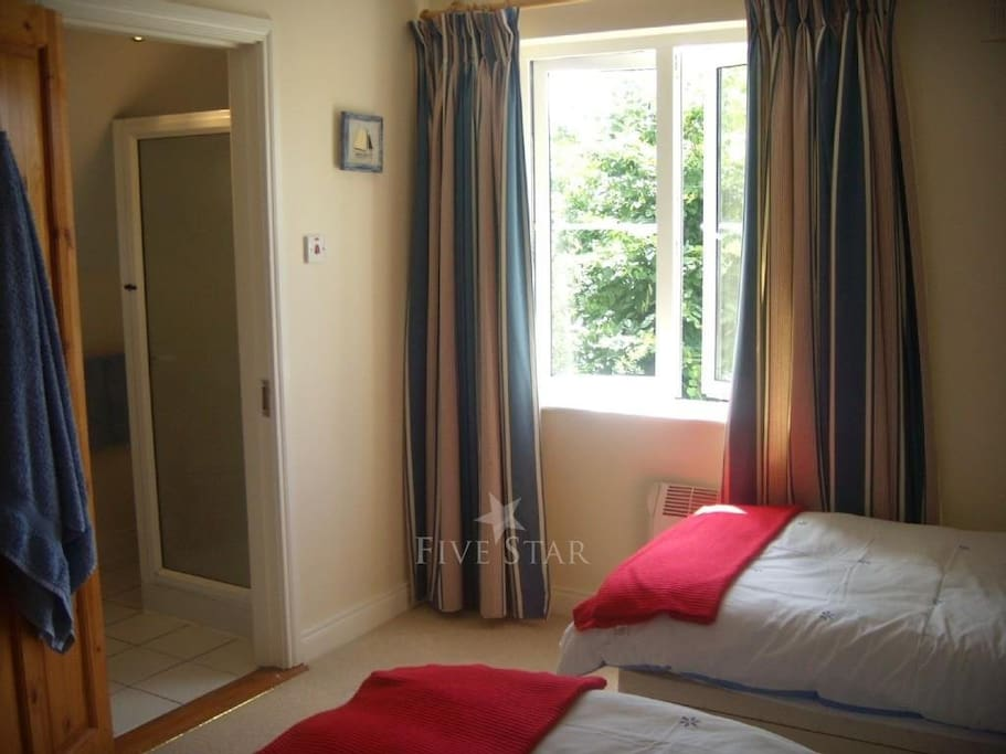 2 Single beds with additional floor matress