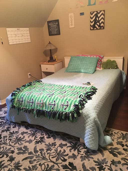 One of the upstairs bedrooms with queen bed and connected to Jack and Jill bath
