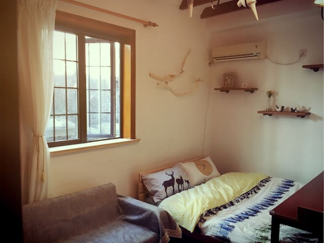Peaceful cabin in centre of modern city ~