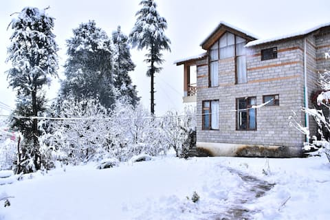 Snow peaks from comfort of your bed| Near Hadimba