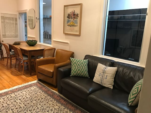 leather couch , extra sofa bed in lounge