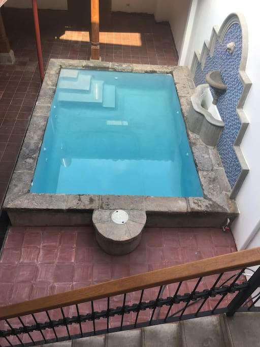 view of pool from upstairs landing.