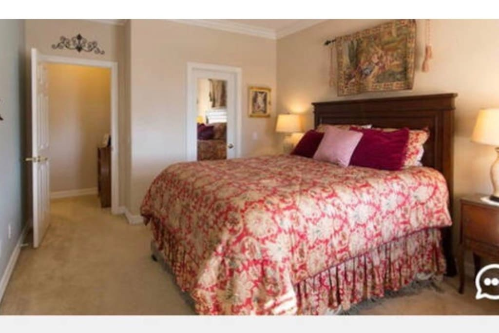 """""""Heavenly"""" bed with view of ocean. Private sink with """"Jack and Jill"""" style bathroom. Plush robe and Walk-in closet. Room to set up portacrib."""