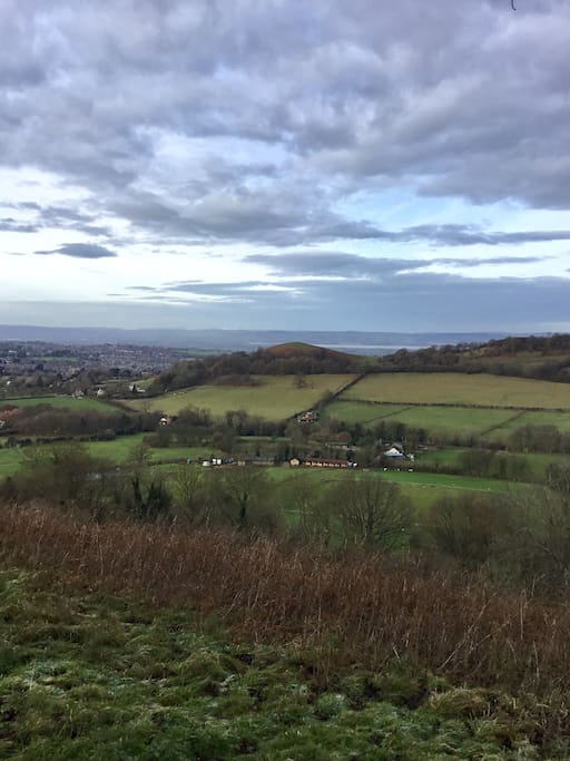 From the top of Downham hill looking back towards the cottage, you can see the Peaked Down, and the river Severn.