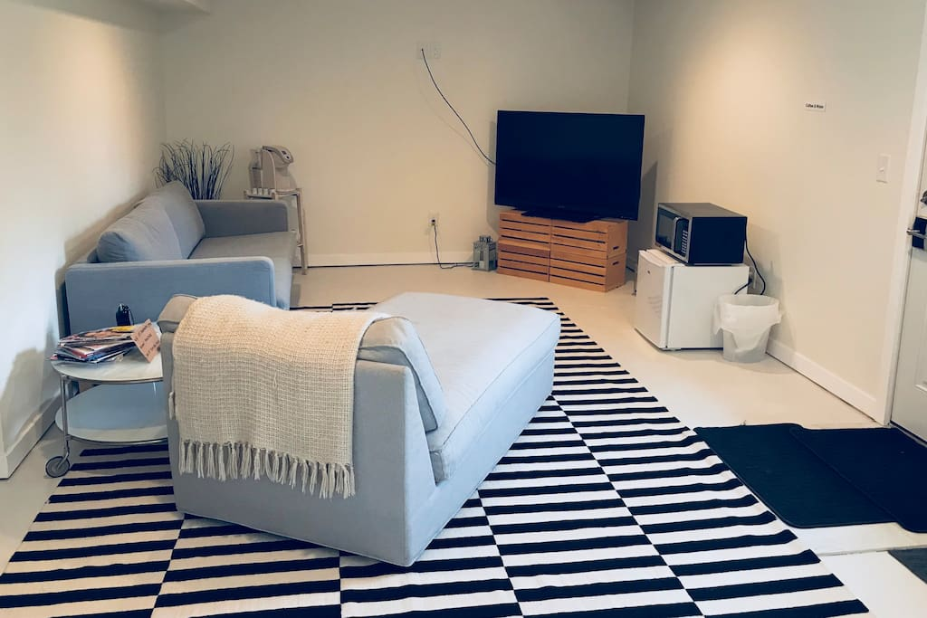Private living area for guests with mini fridge, microwave and coffee