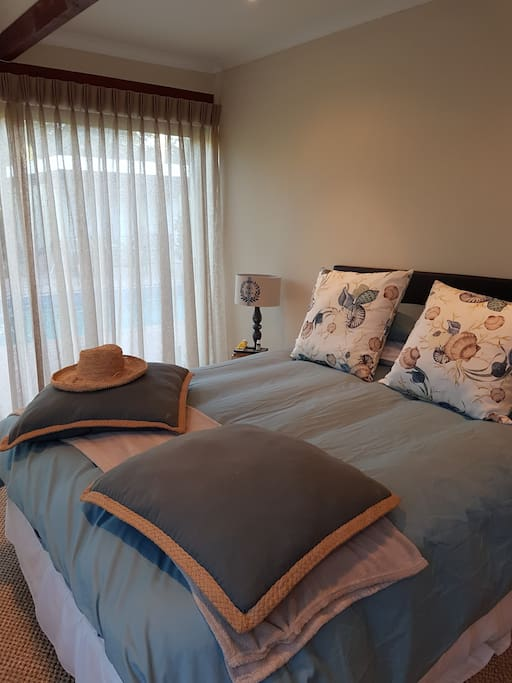 Master bedroom with king size bed, views of pool and mountain , en suite bathroom with separate bath and shower