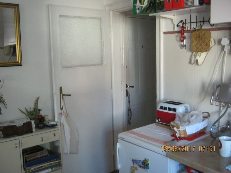 Kitchen with microwave, toaster refrigirator and kitchen sink for quick breakfast.