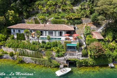 Exclusive villa directly on Lake Lugano with boat