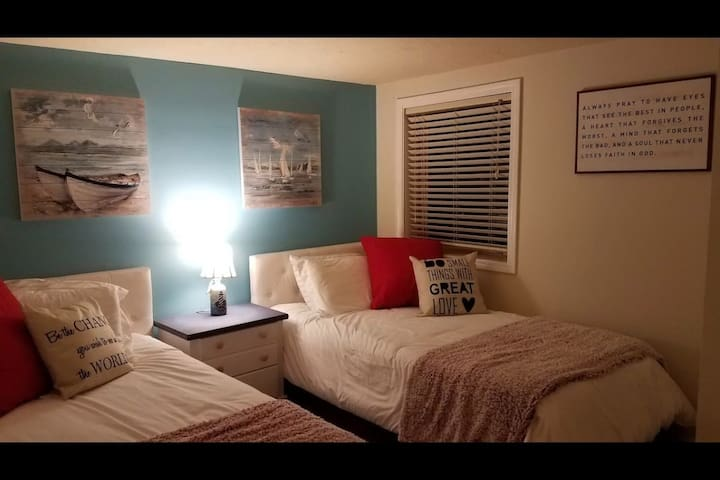 Twin beds in downstairs bedroom