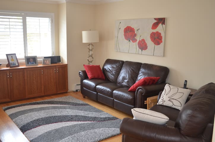 family room with reclining sofa and love seat