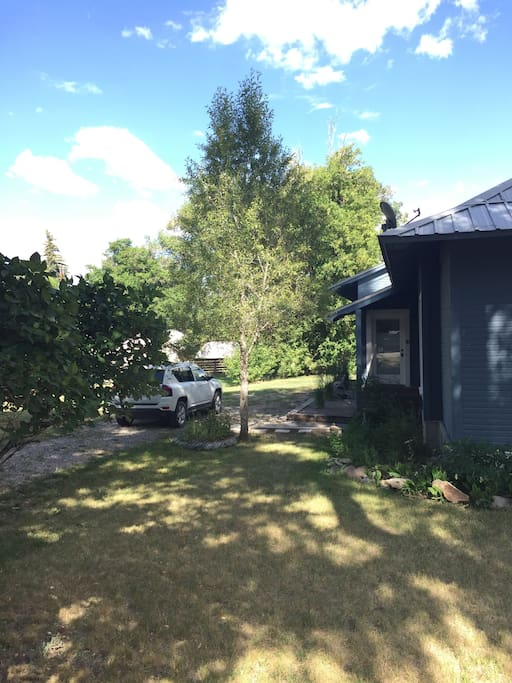 Plenty of parking for your car, SUV, trailer. Large extra yard to the side (left) for running, sprinkler, games (all fenced).