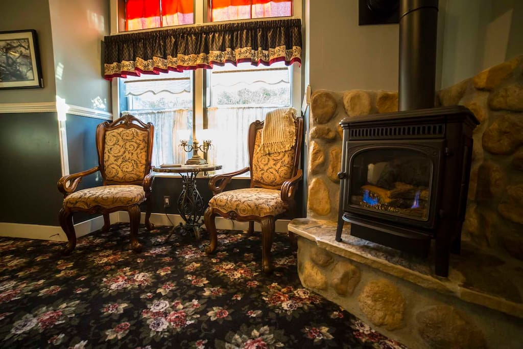 Relax and enjoy a good book while in front of the stove or gazing out the bay window