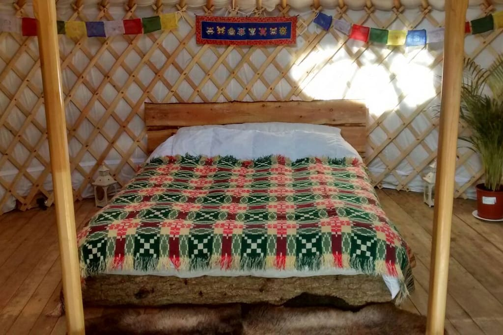 Kingsize bed handmade from a whole tree