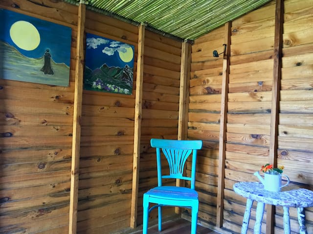 Revamped Wendy House surrounded by indigenous herbs.