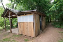 Outdoor Shower House. Trail leading to the Baby Yurt.