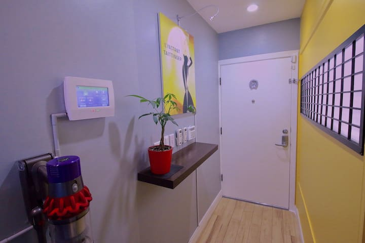 Main Entrance - This door opens to an interior common-area hallway. Philips Hue Lighting (Control via app or wall-switch)