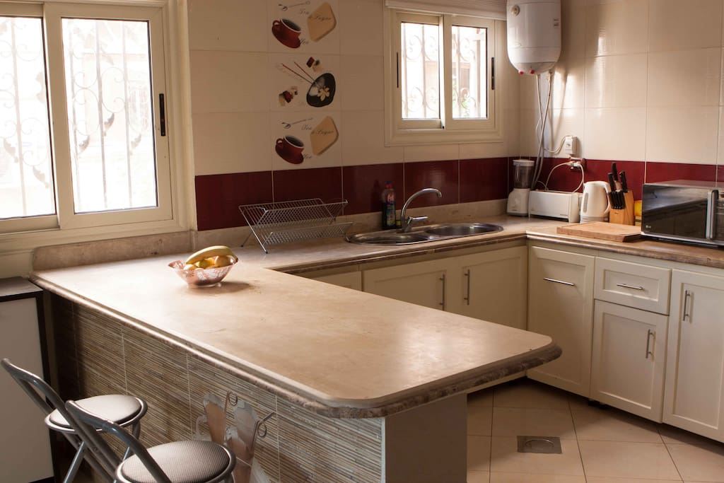 Fully equipped and stocked kitchen area.