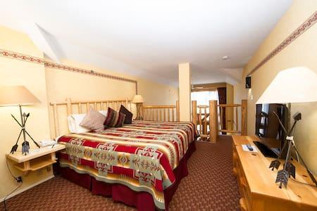 King bed in upper loft area