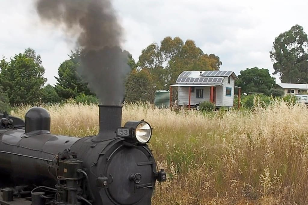 Victorian Goldfields Railway steam engine passes our tiny house.