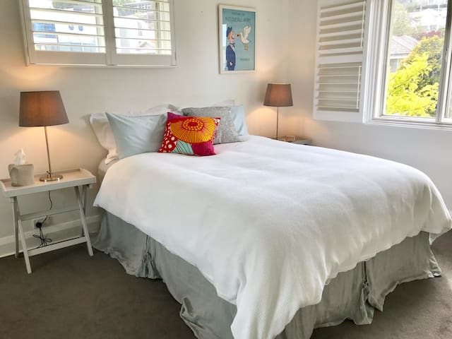 Spacious Bedroom in Charming Bayside Apartment