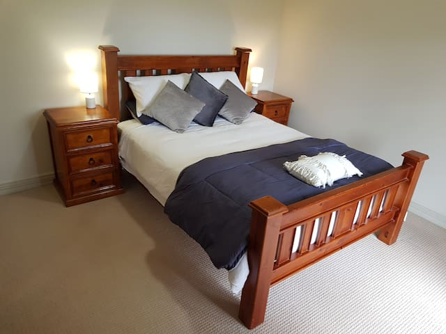 The front garden room, has a comfortable queen sized bed, and french doors that open to the cottage garden.