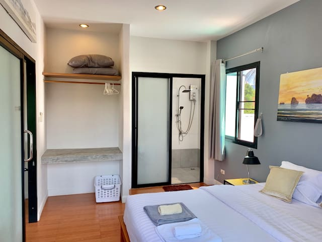 private bed room with an air conditioner and private shower room