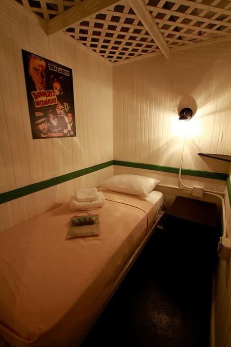 Cabin sleeps one.  Has trellis ceiling and shared bathroom.