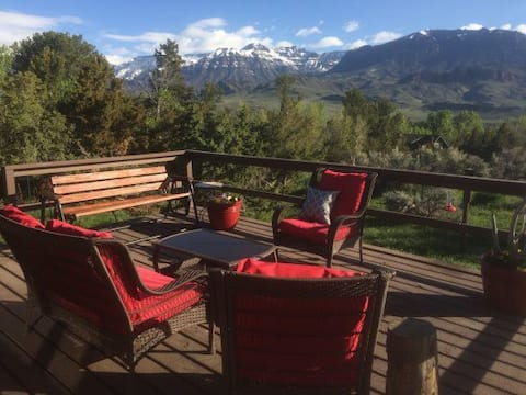 Pet-friendly home tucked away on two acres with breathtaking mountain views!